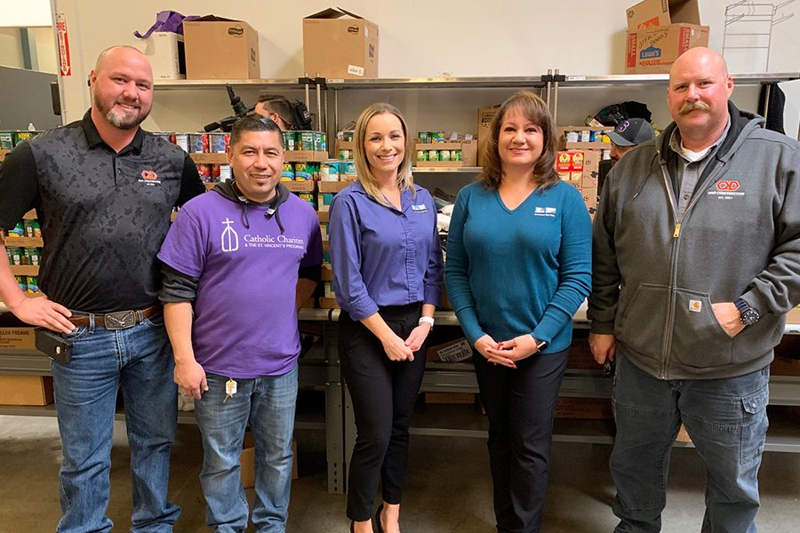 Q&D Employees Volunteer at Catholic Charities